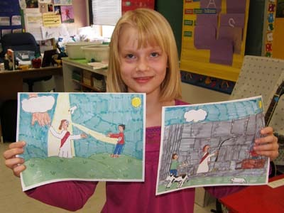 Nine-year-old Alyssa Andres holds up the artwork that won her a week at Bar Lazy J Guest Ranch in Colorado.