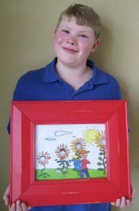 Addison holds up his winning art.
