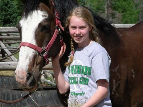 Lydia loved her horse at Medicine Bow Lodge